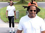 Jay-Z flashes a smile as he enjoys a walk near his Hamptons vacation home wearing head-to-toe Puma
