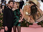 Claims Liam Hemsworth was unhappy Miley Cyrus 'acted up for cameras'