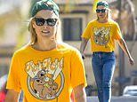 Ali Larter dons a graphic t-shirt and backwards baseball cap on a walk around the Pacific Palisades