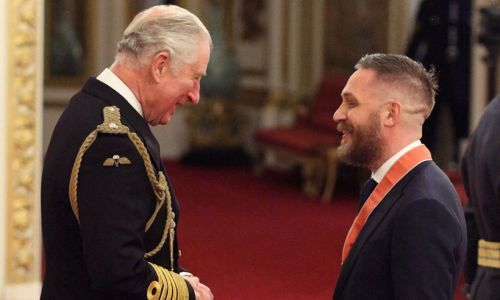 Tom Hardy laughs with Prince Charles after receiving CBE