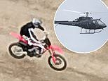 Tom Cruise practises his Mission: Impossible 7 motocross and helicopter stunts in Oxfordshire field