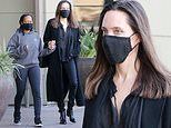 Angelina Jolie holds hands with daughter Zahara, 16, during afternoon Target run