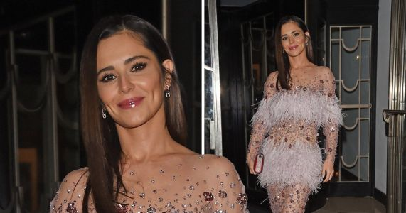 Cheryl is one glamorous wedding guest as she watches friend tie the knot
