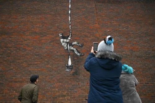 Banksy confirms he's behind new 'escaping inmate' street art on side of prison