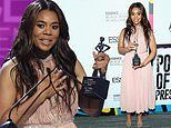 Regina Hall dons pink pleated dress and receives trophy at Essence Black Women in Hollywood Awards