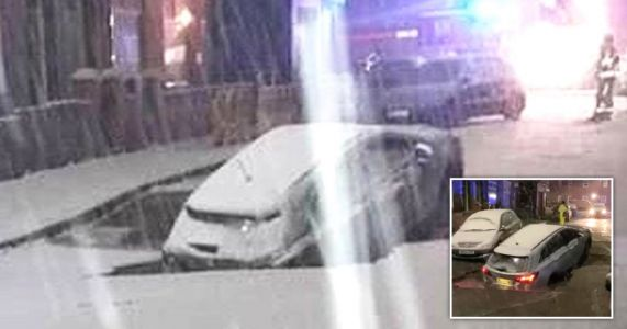 Sinkhole opens up and swallows car as Storm Christoph batters Manchester
