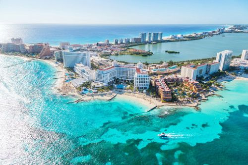 Mexican city Cancún offers free hotels, meals, theme park tickets and car hire to entice tourists back after coronavirus