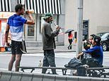 Homeless men are seen sharing swigs of liquor and urinating outside luxury Upper West Side hotels