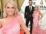 Kristin Chenoweth lights up the 53rd CMA Awards in a pink gown while accompanied by Josh Bryant
