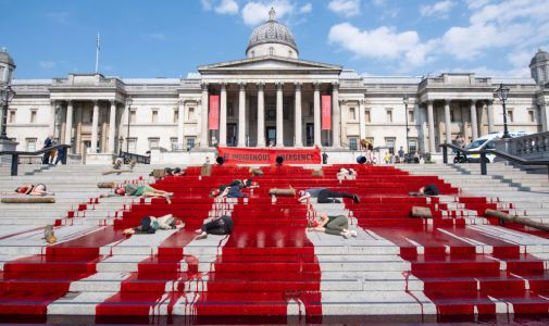 Extinction Rebellion protesters cover Trafalgar Square in fake blood