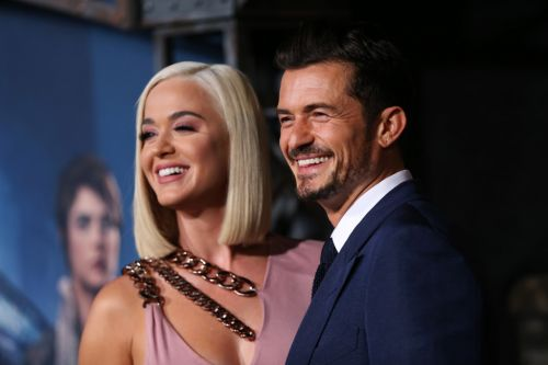Orlando Bloom recalls first meeting fiancée Katy Perry while stealing a burger from Denzel Washington