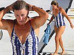 Deborah Hutton, 58, stuns in a blue and white swimsuit while taking a dip at Bondi Icebergs