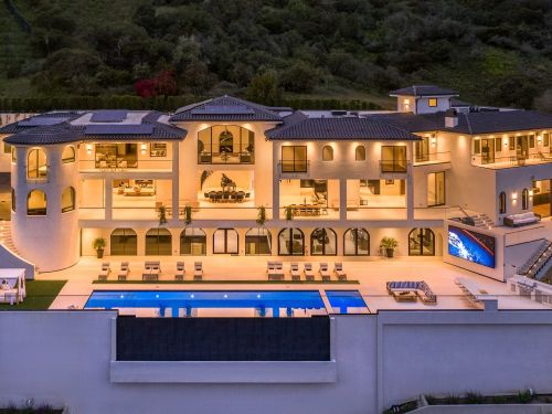 A resort-like Bel Air mega-mansion once listed for $100 million just got a major price cut - take a look inside