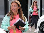 Coleen Rooney cuts a casual figure in a pink top and black leggings as she departs hair salon