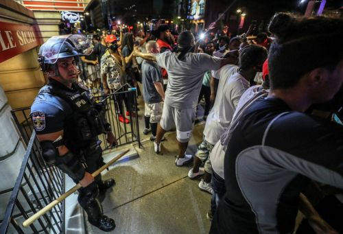 Black protesters form human shield around white officer separated from his unit