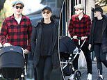 Sylvia Jeffreys and Peter Stefanovic take sweet four-month-old son Oscar for a stroll in Double Bay