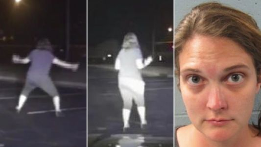 'Drugged' driver embarks on disco dance routine while cop yells orders at her