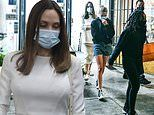 Angelina Jolie wears all white as she takes her kids Zahara and Shiloh shopping in Los Angeles