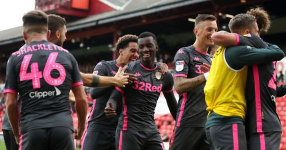 Leeds hit Championship summit as late goals sink battling Barnsley