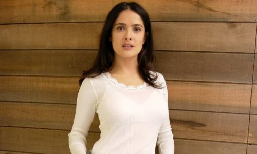 Salma Hayek is snow bunny chic in skinny jeans alongside a special man - photos