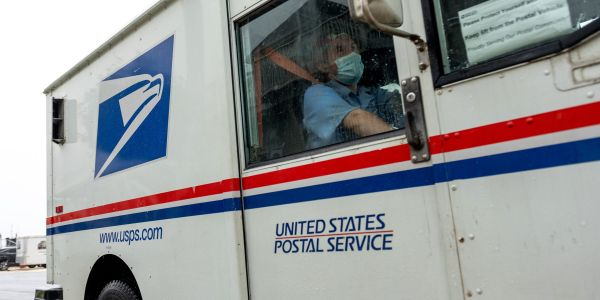 Protesters gather outside of US postmaster general's home and stage a 'noise demonstration' over his cuts to USPS