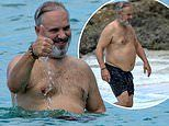 Sam Mendes goes shirtless during trip to the beach while soaking up the sun in Barbados