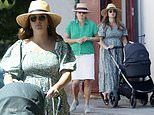 Millie Mackintosh takes her three-week-old daughter for a stroll with mum Georgina