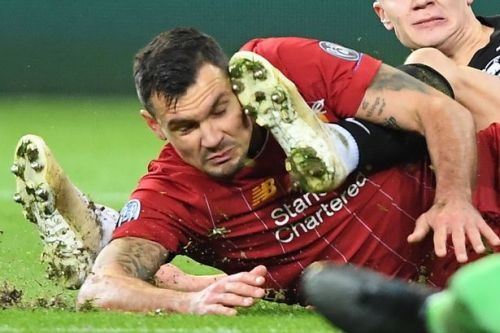 BREAKING Dejan Lovren forced off with knee injury in Liverpool's clash with RB Salzburg