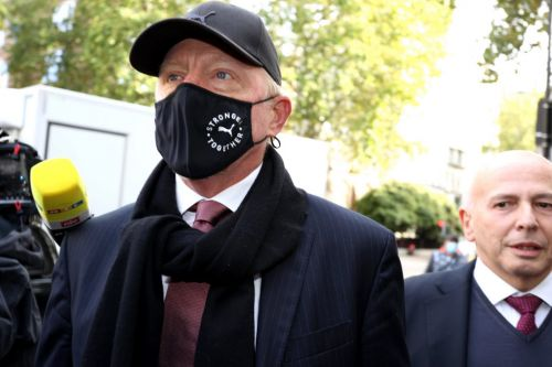 Boris Becker arrives at court as tennis star is charged with failing to comply with bankruptcy proceedings
