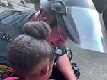 White police officer comforts tearful black girl, 5, during George Floyd protest in Houston