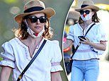Natalie Portman keeps safe by wearing a mask as she visits a dry cleaner in Sydney