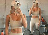 TOWIE's Amber Turner showcases her toned midriff in cream activewear
