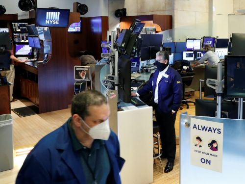 The New York Stock Exchange trading floor just reopened with masks and social distancing required - take a look