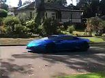 Bizarre moment blue Lamborghini speeds through a suburban street at 8am - as police hunt the driver