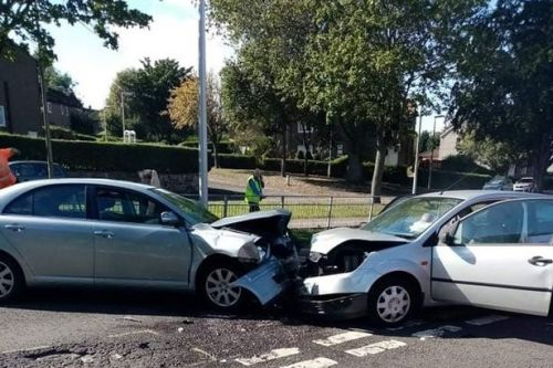 Head-on car crash prompts police to shut down road outside Scots high school