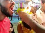 The moment a man eats the world's hottest food fire-paan. and barely bats an eye-lid!