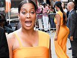 La La Anthony shows off her curves in a form-fitting orange outfit in NYC