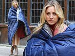 Kaley Cuoco wraps herself in down blanket as she braves the cold