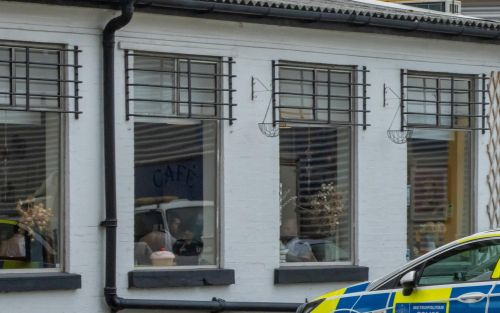 Pictured: Nine police officers fined for eating at cafe in breach of Covid rules