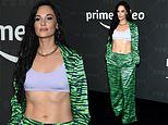 Kacey Musgraves shows taut midriff in neon green at Rihanna's theatrical Savage x Fenty NYFW show