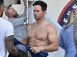 Mark Wahlberg reveals his chiseled abs and muscular biceps during a grueling workout in Los Angeles