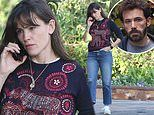 Jennifer Garner wears look of worry as she takes call.. amid Ben Affleck's split from Ana de Armas
