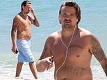 Rod Stewart's son Sean takes a shirtless stroll on the beach in Florida for his daily walk