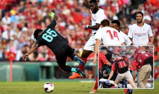 Liverpool fans react as Yasser Larouci stretchered off after horror tackle by Sevilla star