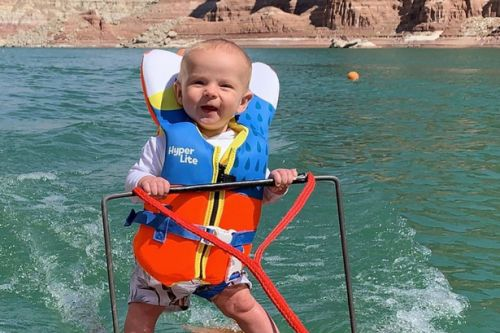 Parents slammed over video showing six-month-old baby jet-skiing solo on a lake