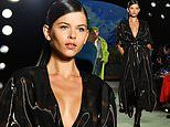 Georgia Fowler oozes sex appeal in a plunging wet-look dress for New York Fashion Week