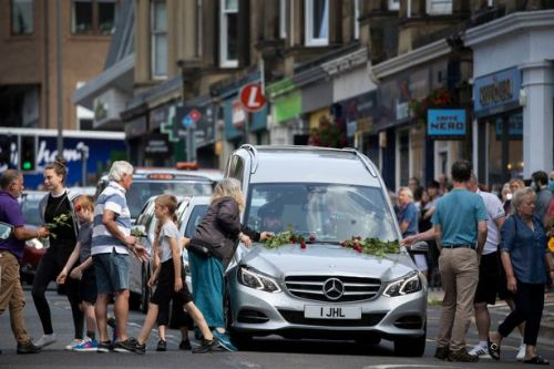 Hundreds place roses on hearse carrying boy, 3, killed when he was hit by car