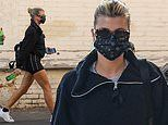 Sofia Richie showcases her toned legs in black tennis skirt while out with a friend in Los Angeles