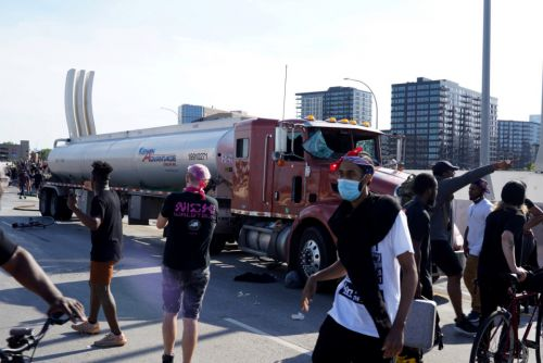 Tanker truck drives through crowd of protesters on Minneapolis highway