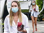 Candice Swanepoel puts on a leggy display in hotpants and loose shirt as she grabs a smoothie